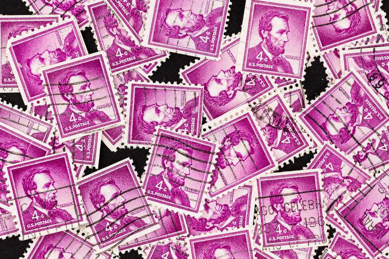 Abraham Lincoln Stamps Background magenta images stock