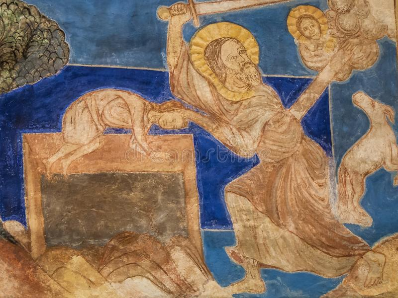 Abraham sacrifices his son Isaac on the altar. Binding of Isaac, God asks Abraham to sacrifice his son, Isaac but is prevented by an angel. A romanesque wall stock photography