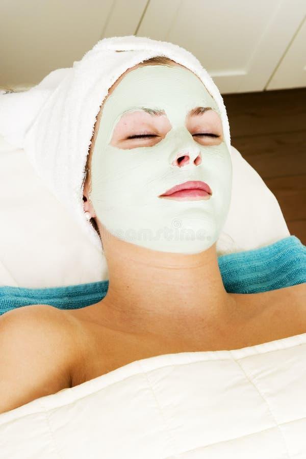 Abrandamento facial da máscara foto de stock