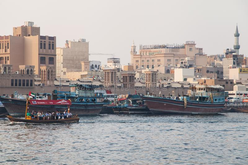 Abras and Dhows in Dubai Creek. Dubai, United Arab Emirates - September 8, 2018: Abras and Dhows in Dubai Creek, Deira, Dubai, United Arab Emirates royalty free stock images