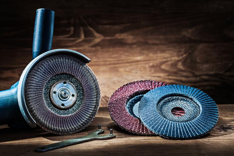 Abrasive tools angle greender with used and new flaw discs stock photography