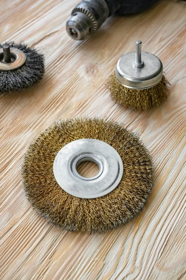 Abrasive tools for brushing wood and giving it texture. Wire brushes on treated wood stock image