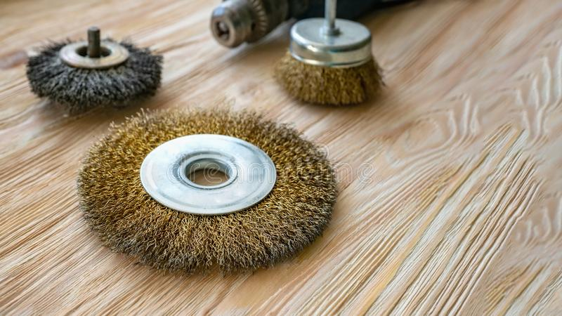 Abrasive tools for brushing wood and giving it texture. Wire brushes on treated wood. Copy space royalty free stock photos