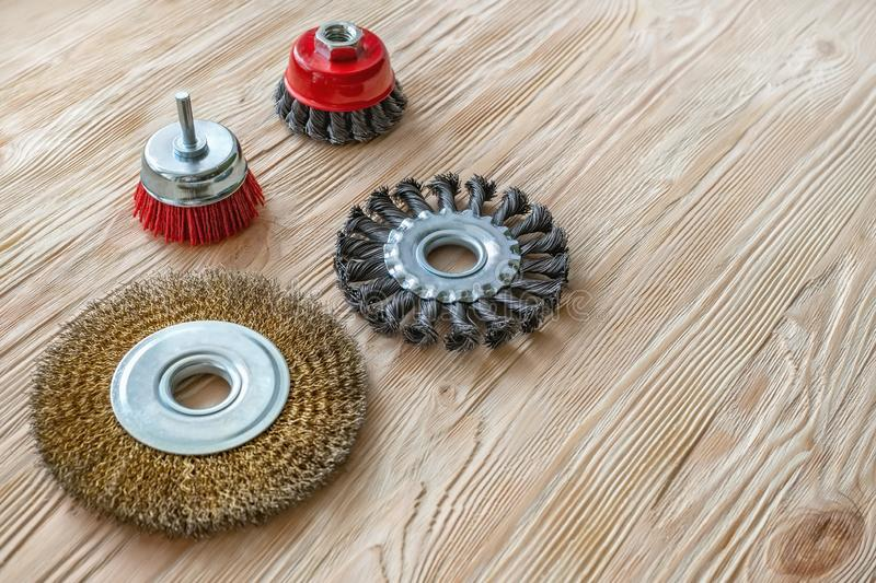 Abrasive tools for brushing wood and giving it texture. Wire brushes on treated wood stock photos