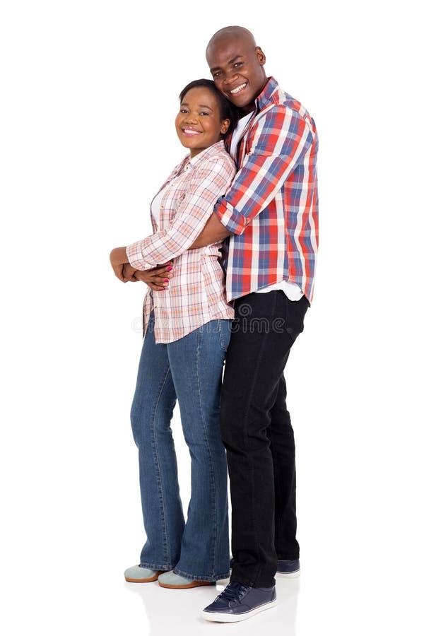 Abrazo negro joven de los pares foto de archivo