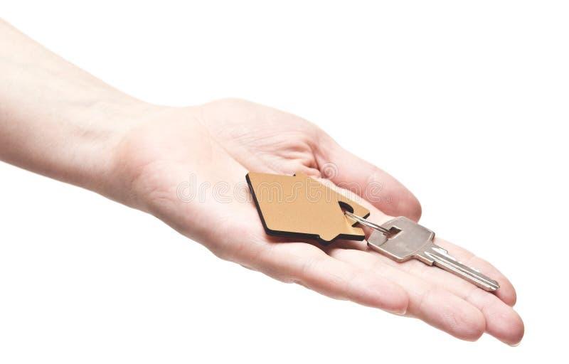 Download Abrigue Chaves Na Mão Fêmea Foto de Stock - Imagem de casa, conceito: 26519492