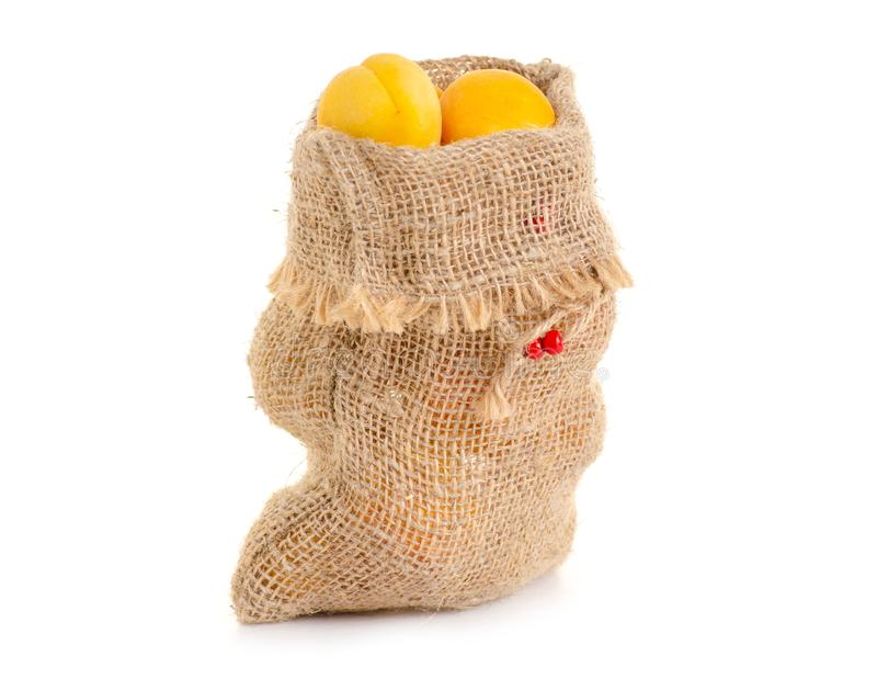 Abrikozen in een zak oranje fruit stock afbeeldingen