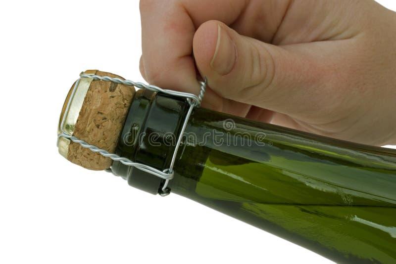 Abrindo um frasco de Champagne. imagens de stock royalty free