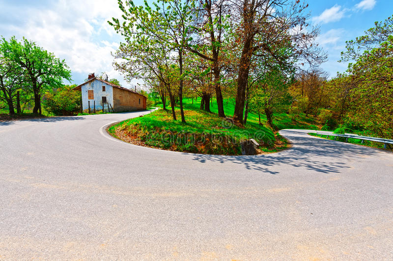 Abrupt Bend. In the Asphalt Road in the Italian Alps stock photos