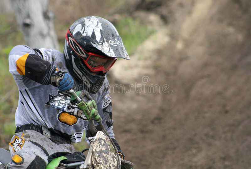 On abrupt turn. The young sportsman - motorcycle racer makes abrupt turn at competitions stock photos