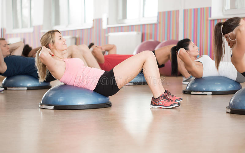 Abs exercise on bosu ball royalty free stock photography
