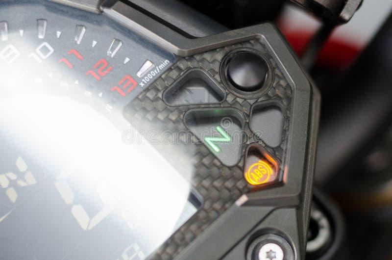 Anti-lock braking system ABS light on motorcycle dashboard royalty free stock photography