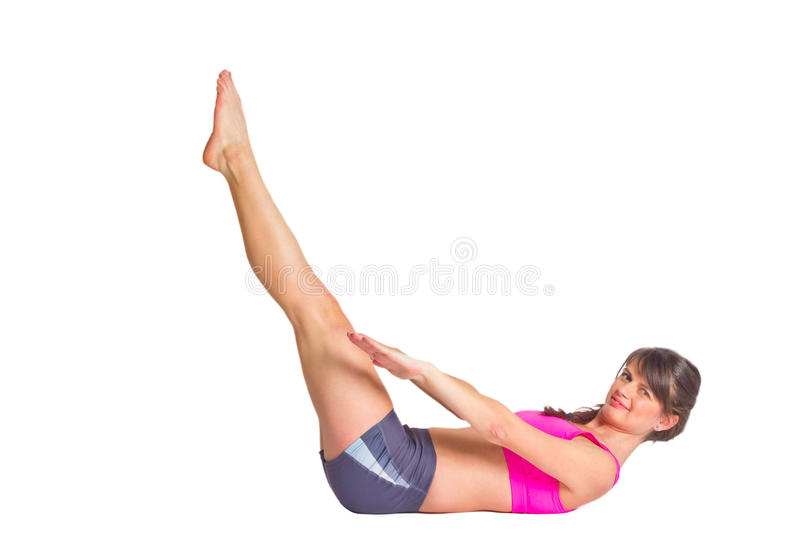 Abs workout. Fit young woman doing abs workout. Isolated on white background royalty free stock image