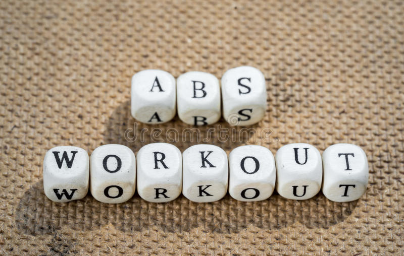 Abs workout. Words made from toy cubes with letters royalty free stock image