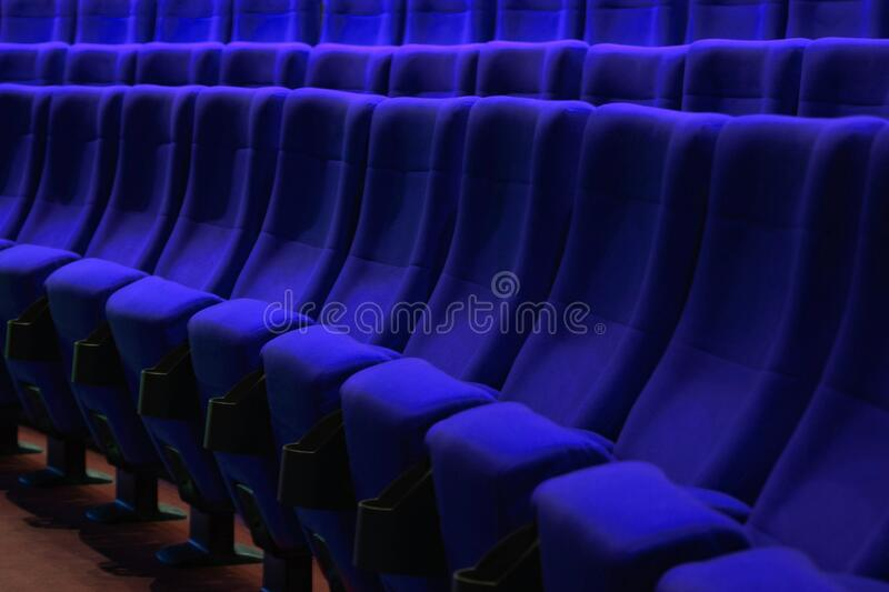 Absolutely empty blue chairs in cinema with nobody stock photos