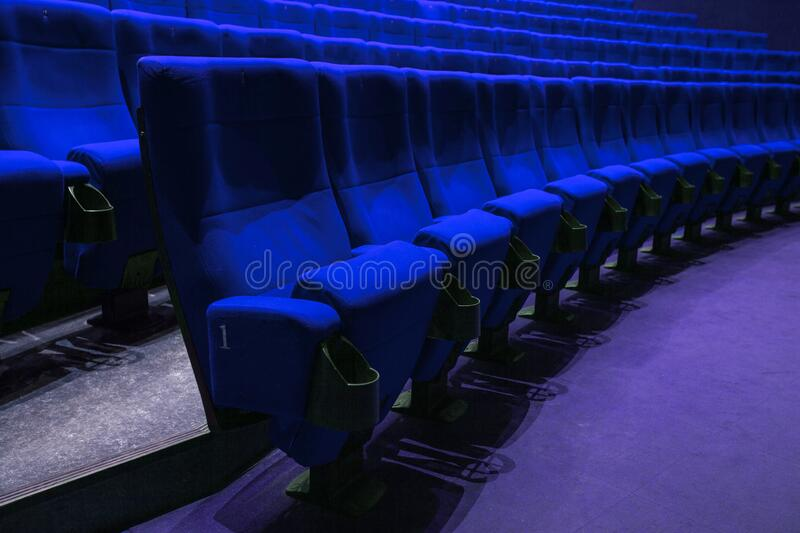 Absolutely empty blue chairs in cinema with nobody royalty free stock images