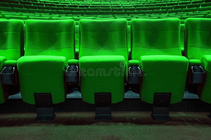 Absolutely empty green chairs in cinema with nobody royalty free stock photo