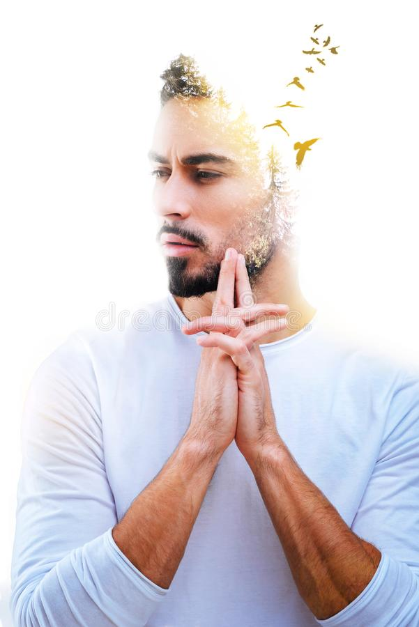 Handsome bearded man imagining birds royalty free stock images