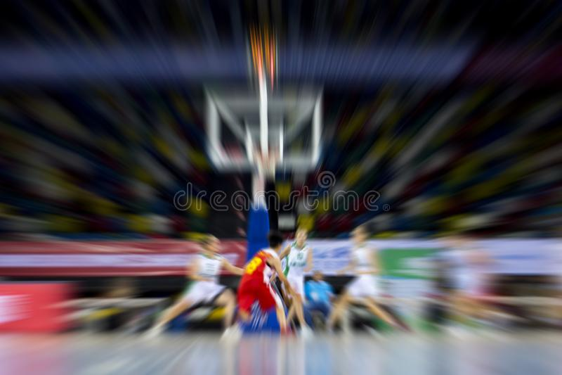 Absract zoom in moving basketball game.  stock images