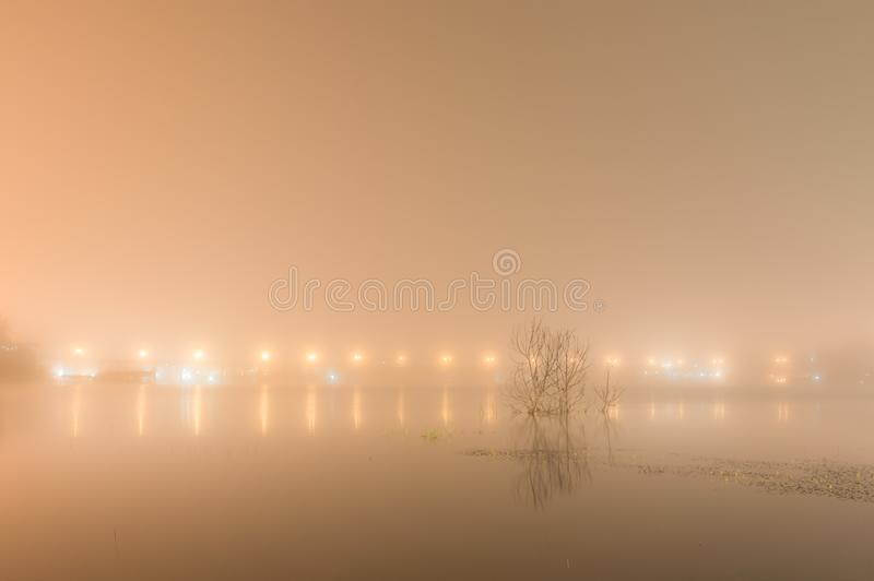 Abstact blurred background of Uttamanusorn Bridge or Mon Bridge. With light reflection and fog on river in the evening at Sangkhlaburi district,Kanchanaburi stock images