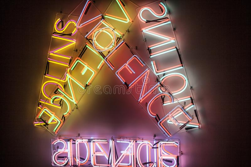Abstact colorful neon signs with a violence word on dark bagckround. Neon life stock photo