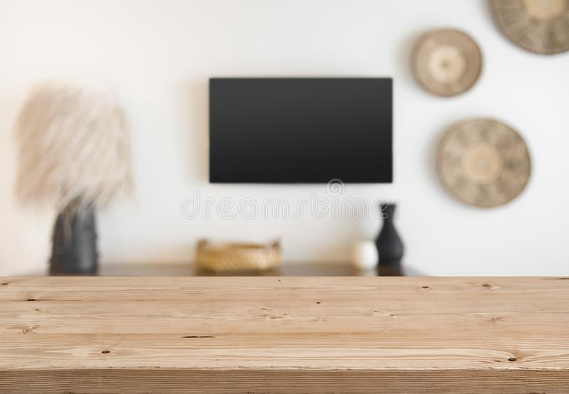Abstact defocused tropical hotel wall with wooden table in front.  stock photo