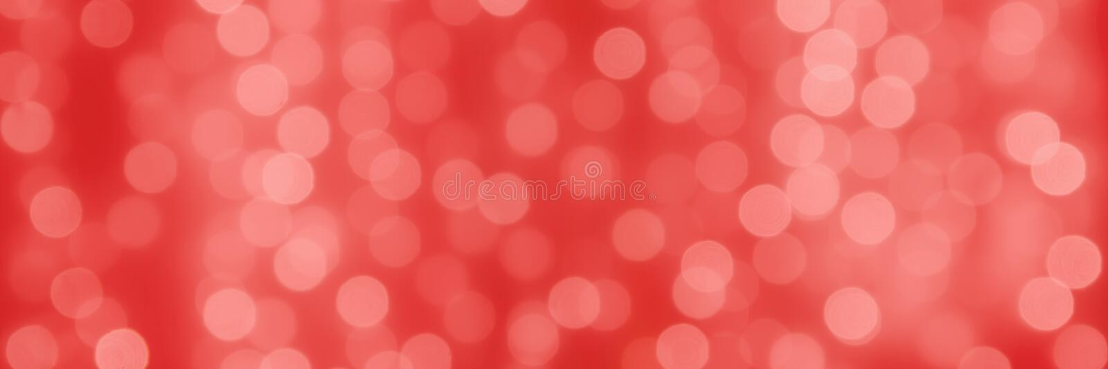 Abstact holiday coral background with bokeh light balls.  stock photo