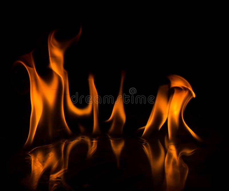 Abstact wallpaper fire flames on black background.  royalty free stock images