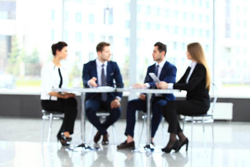 Abstakt image of people in the lobby of a modern business center royalty free stock image