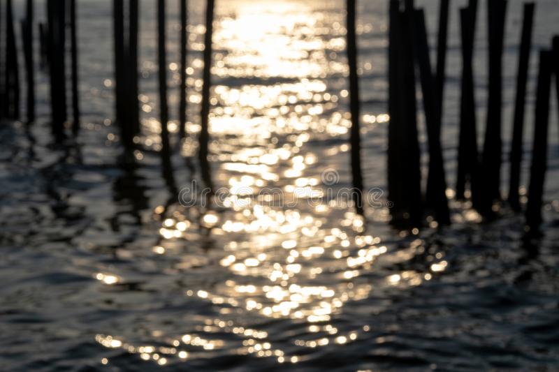 Abstarct Bokeh of Sea Wave and Bamboo Wave Wall Protection in t. He Sea royalty free stock photo