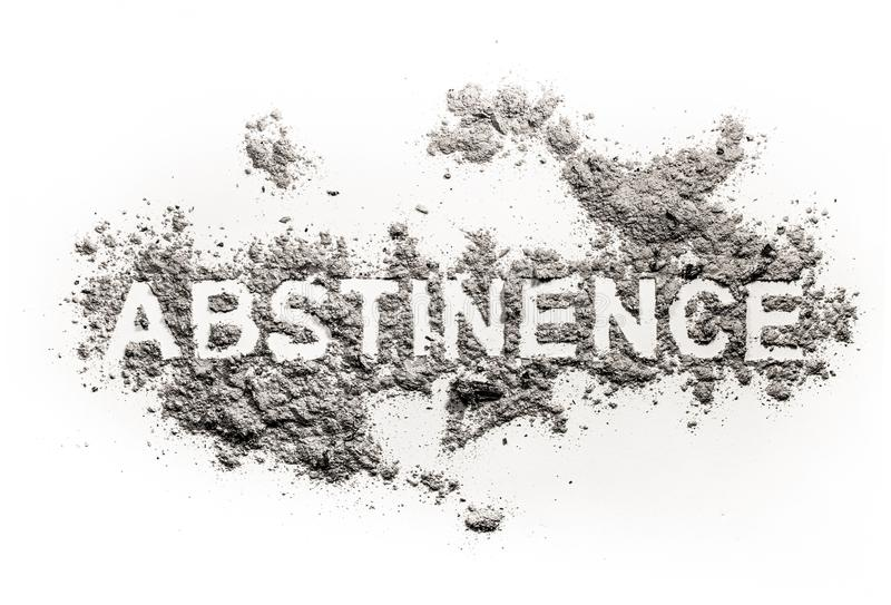 Abstinence word written in ash, sand or dust. As alcohol, drug, sex, food or medicine refusal or forbidden, bad habit obsession, health danger as alcoholism or royalty free stock photo
