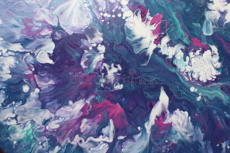 Abstract acrylic pour painting which resembles a crashing tempest at sea. This is a closeup on one section of an abstract acrylic pour painting which uses the royalty free stock photo