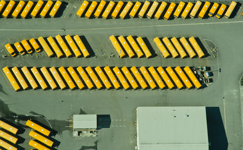 Abstract Aerial View of School Bus Depot. Large school bus depot and maintenance garage in Auburn, Washington stock image