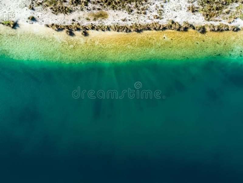 Abstract aerial view of the shore of a gravel pond, much free sp stock image