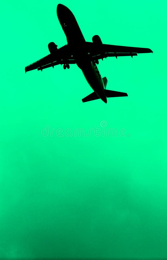 Abstract airplne with green backround stock photography