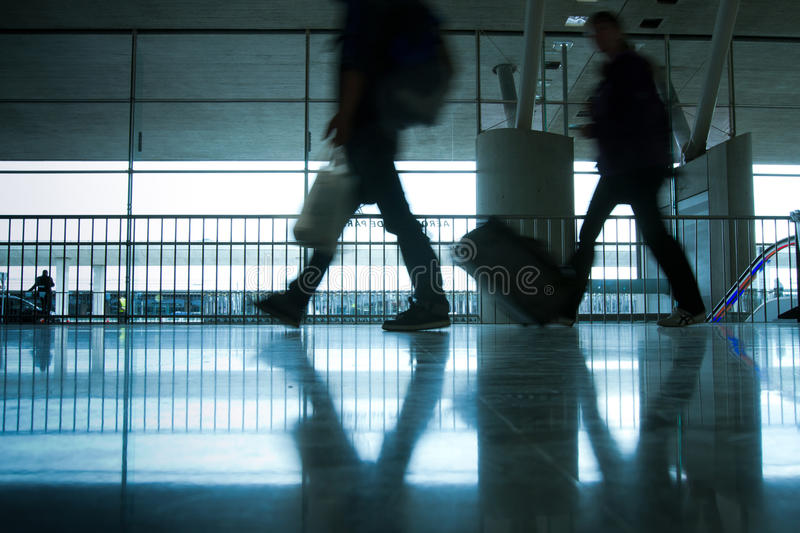 Abstract airport. And silhouette of people walking with luggage royalty free stock photos