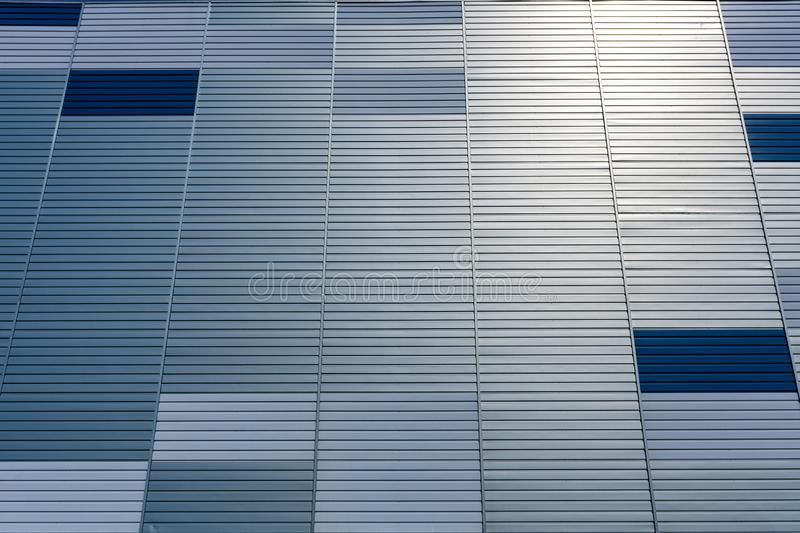 Abstract architectural background from modern buildings facade with blue and silver lines - image royalty free stock image