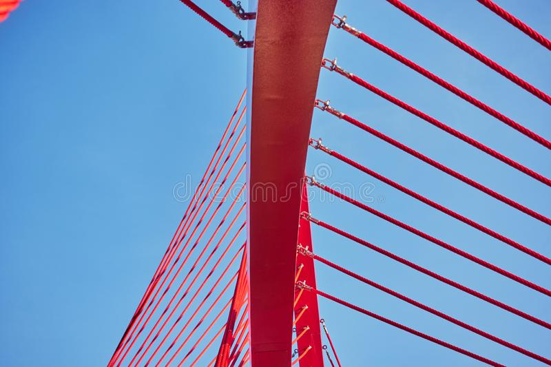 Abstract architectural features, steel beam with cables on sky background.  stock photography