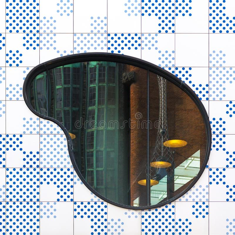 Abstract architectural picture with blue dotted facade and shape. Abstract architectural picture with blue dotted facade, shaped window and industrial reflection stock images