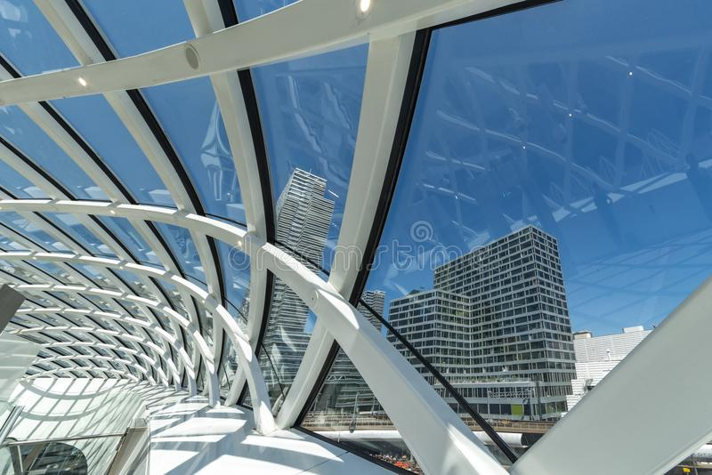 Abstract architectural structure on blue. Curly grid shape glass ceiling under a bright sunny blue sky abstract royalty free stock photography