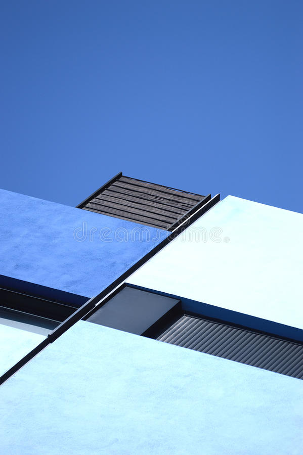 Abstract architecture background. Blue geometry. Abstract architecture background. Blue geometry against sky stock photography