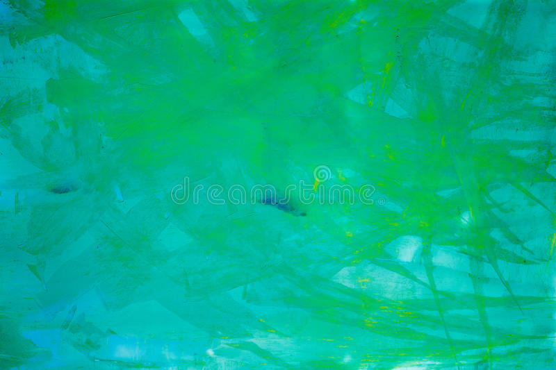 Abstract art background. Oil painting on canvas. Green and yellow texture. Fragment of artwork. Spots of oil paint stock images