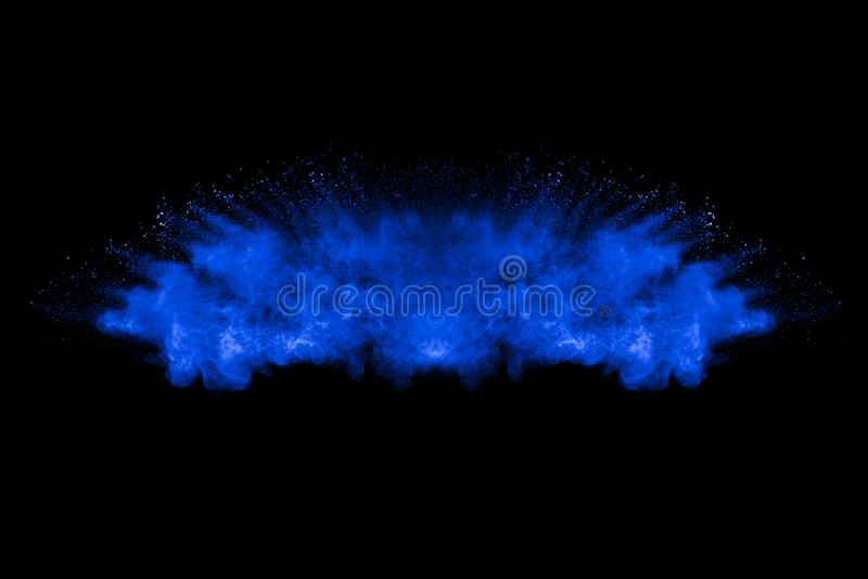 Abstract art blue powder on black background. royalty free stock photos