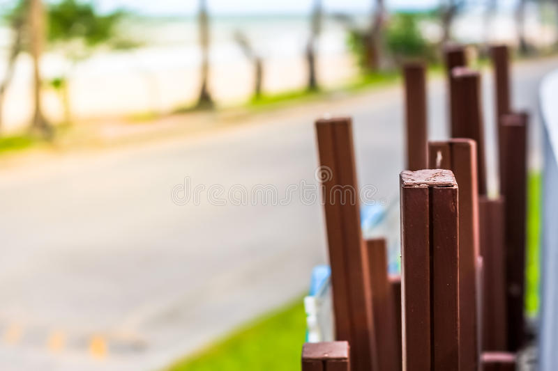 Abstract art of the brown wooden stick with road background stock photos