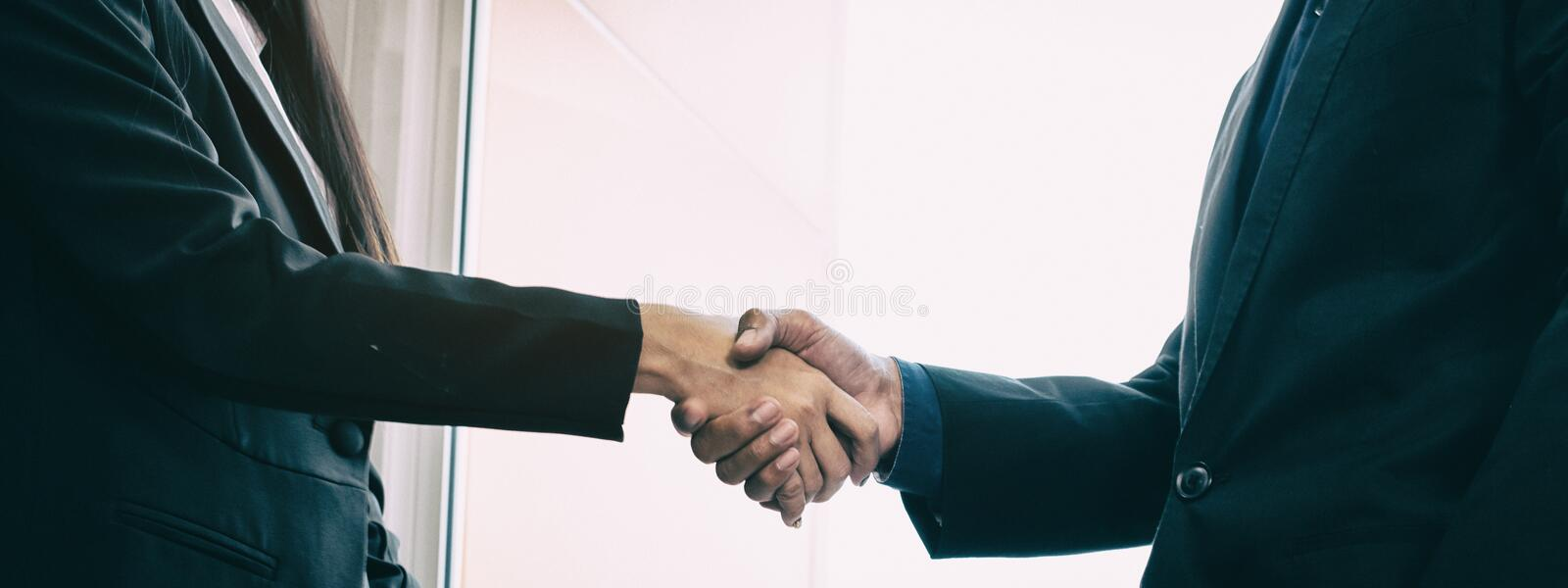 The abstract art design background of business workers are shaking hand,business hand sign of success,team work,collaborator stock images