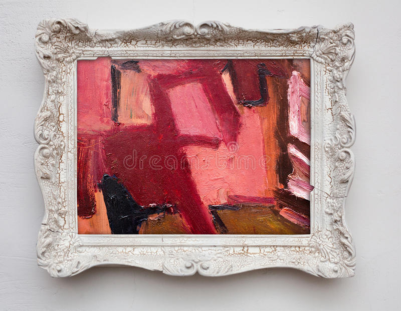 Abstract art expressionism canvas in vintage antique white frame. On the white wall. See more in my portfolio royalty free stock photography