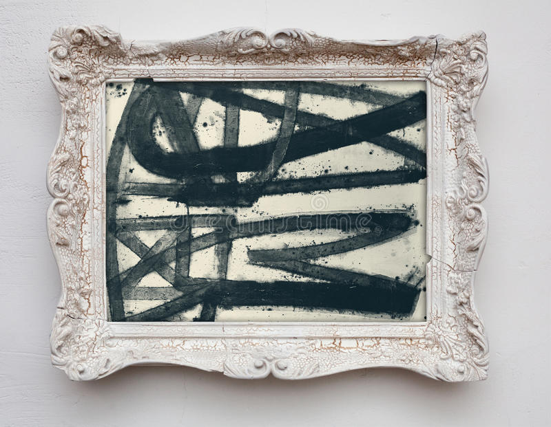 Abstract art expressionism canvas in vintage antique white frame. On the white wall. See more in my portfolio royalty free stock photos