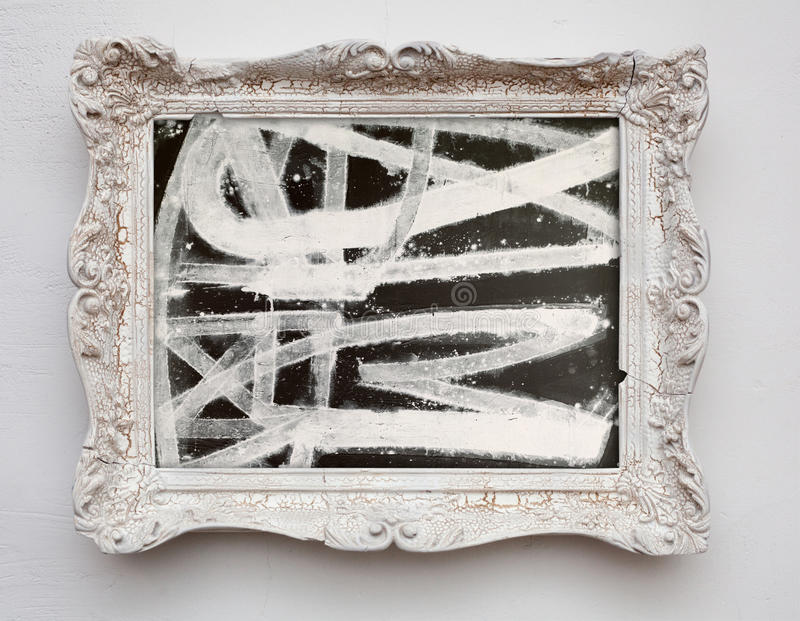 Abstract art expressionism canvas in vintage antique white frame. On the white wall. See more in my portfolio stock image