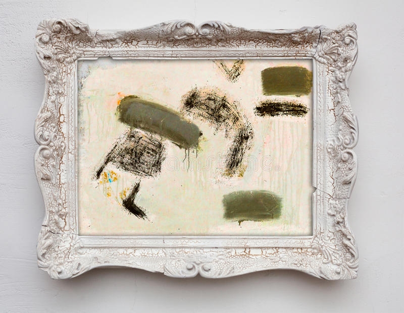 Abstract art expressionism canvas in vintage antique white frame. On the white wall. See more in my portfolio royalty free stock images