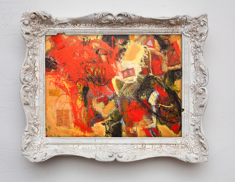 Abstract art expressionism canvas in vintage antique white frame. On the white wall. See more in my portfolio stock photo